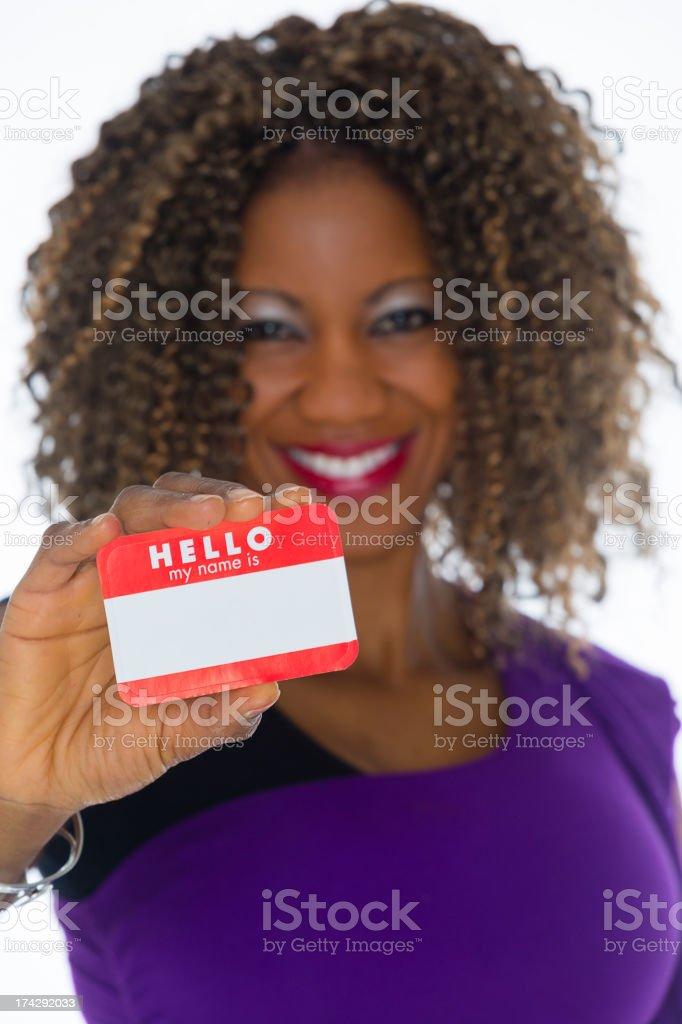 Woman Holding Nametag stock photo