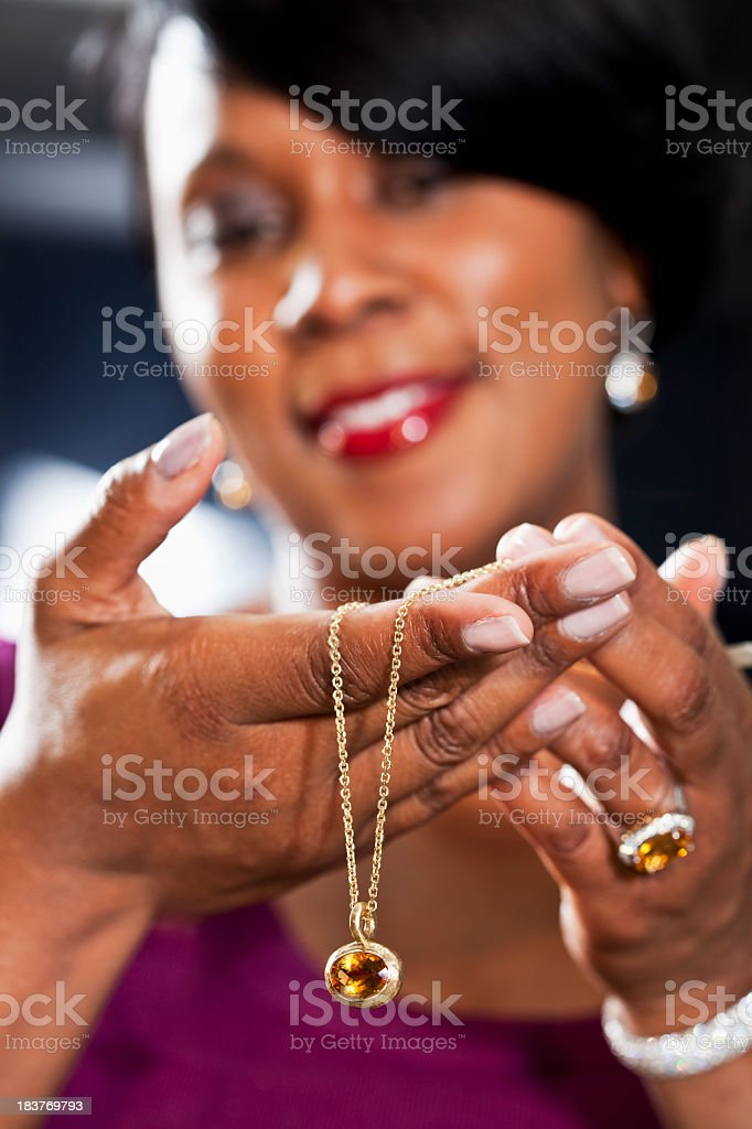 Woman holding necklace in hands stock photo
