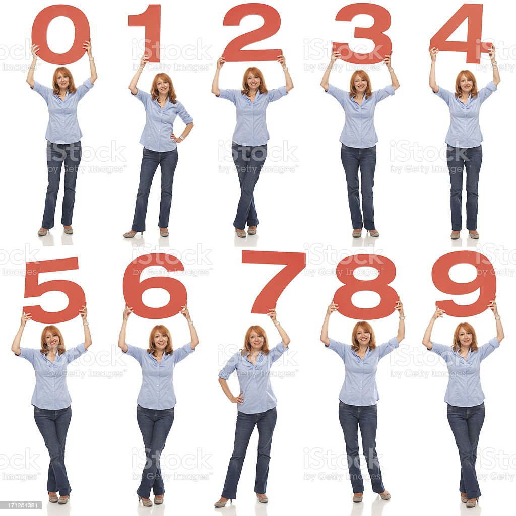Woman holding numbers. stock photo