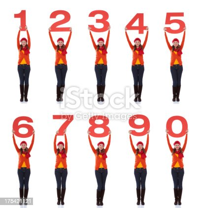 istock Woman holding numbers. 175421121