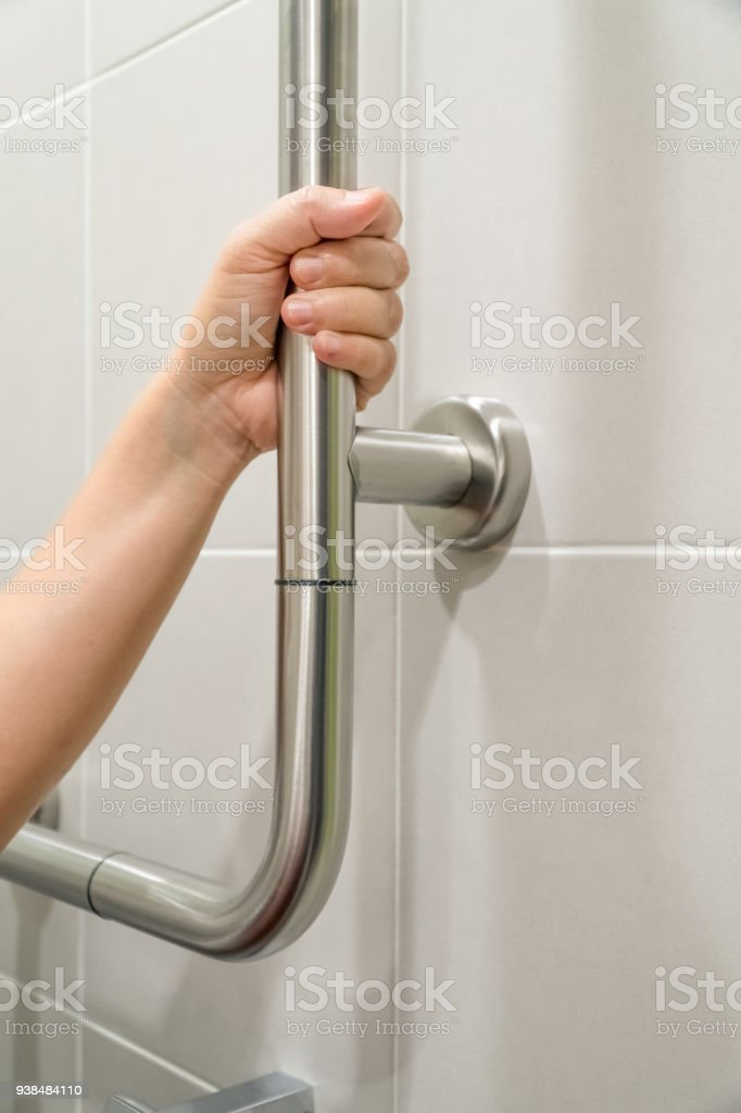 Woman Holding On Handrail In Toilet Stock Photo & More Pictures of ...