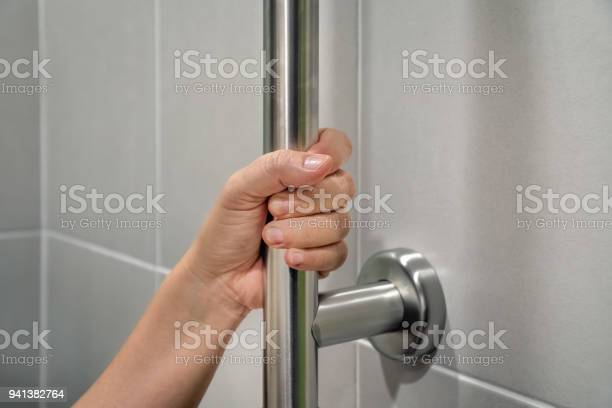 Woman holding on handrail in toilet picture id941382764?b=1&k=6&m=941382764&s=612x612&h=1hzrbq oorwxm3mecqav2 21qvwkpxst2fj1wfzmr6o=