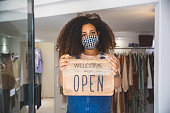 Open sign in a small business boutique shop after Covid-19 pandemic