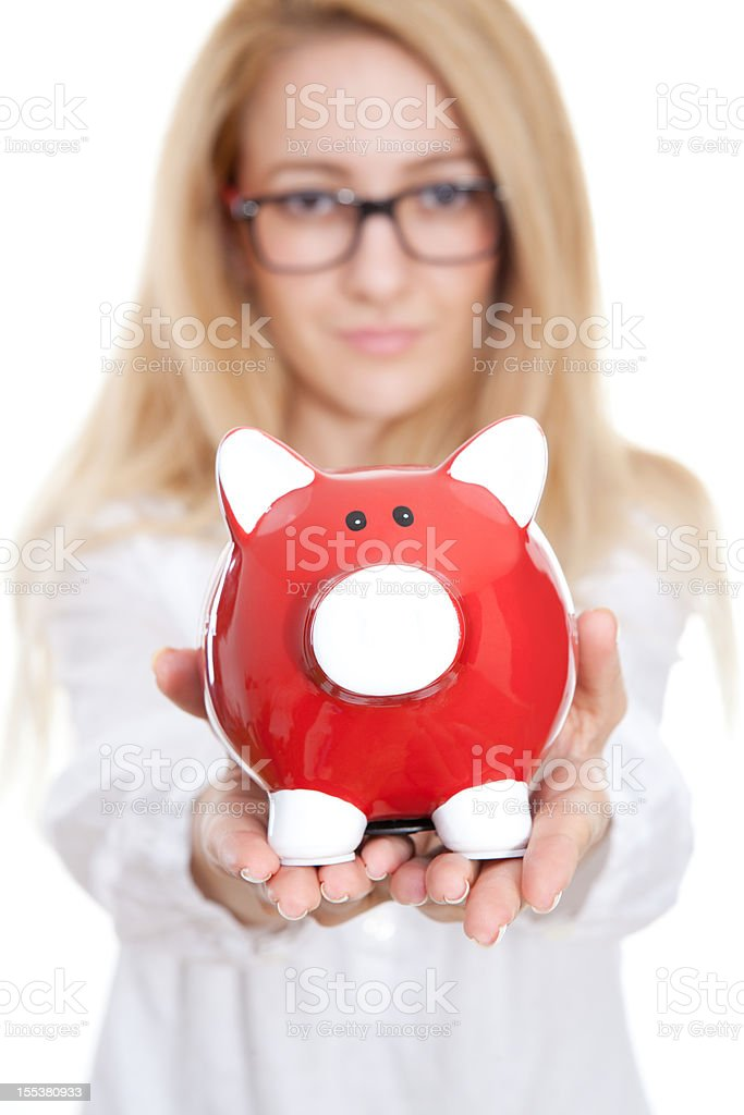 Woman holding out a piggy bank royalty-free stock photo
