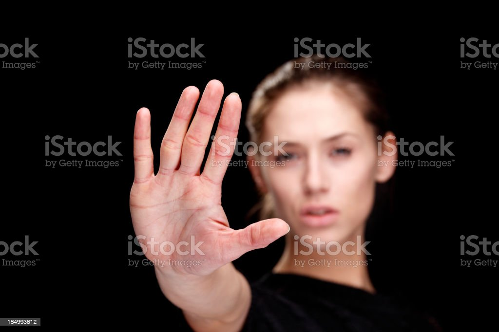 Woman holding out her hand to signify 'Stop ' stock photo
