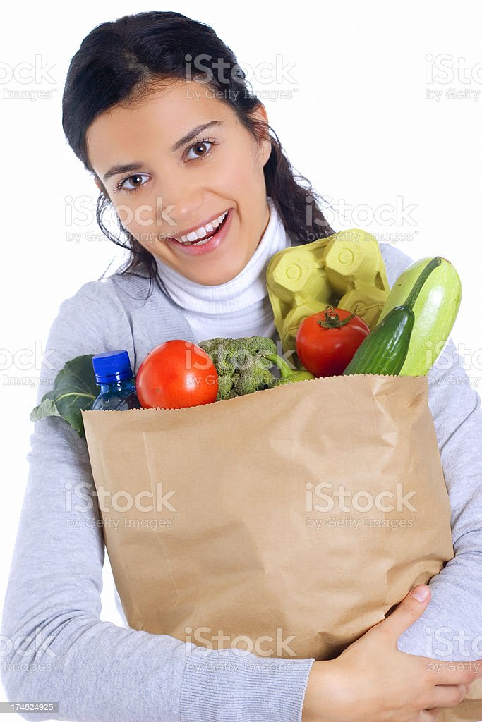 woman holding paper bag full of groceries royalty-free stock photo