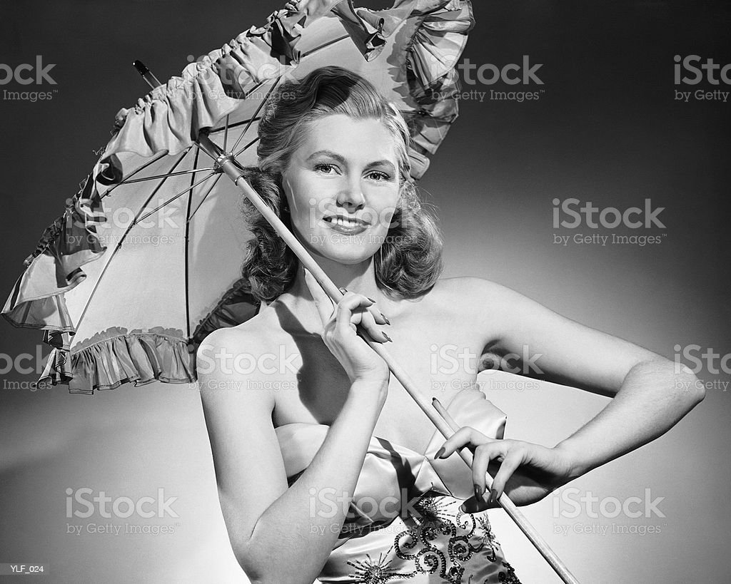 Woman holding parasol royalty-free stock photo
