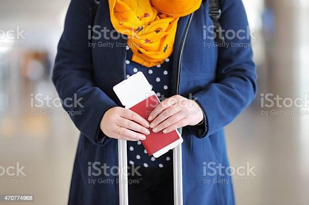 Woman holding passport and boarding pass picture id470774968?b=1&k=6&m=470774968&s=612x612&h=xltbpajy8utpjgbfw 7fphvcfkt6atjlvclnkpqr7ue=