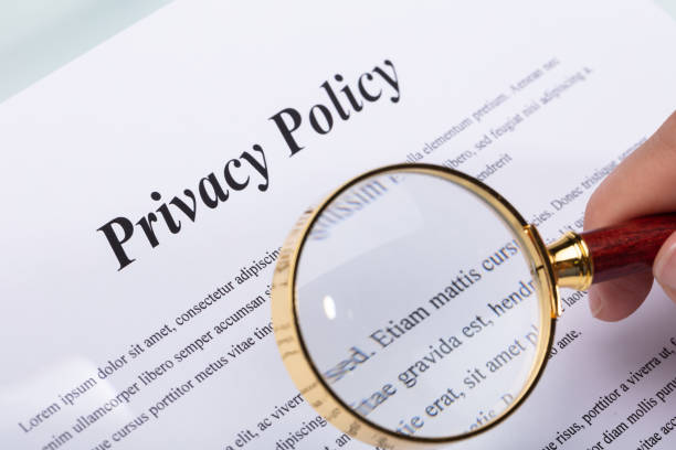 woman holding pen over privacy policy form - privacy policy stock photos and pictures