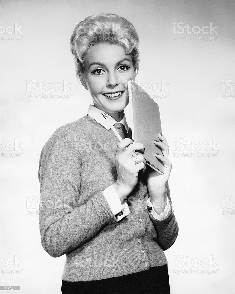 Woman holding pencil and paper royalty free stockfoto