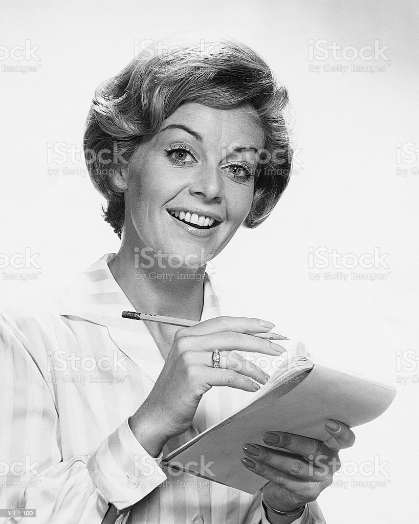 Woman holding pencil and paper royalty-free stock photo