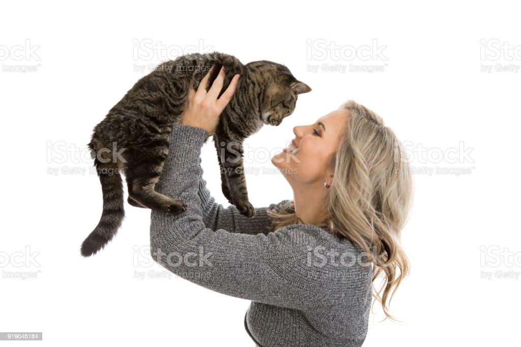 Woman Holding Pet Cat stock photo