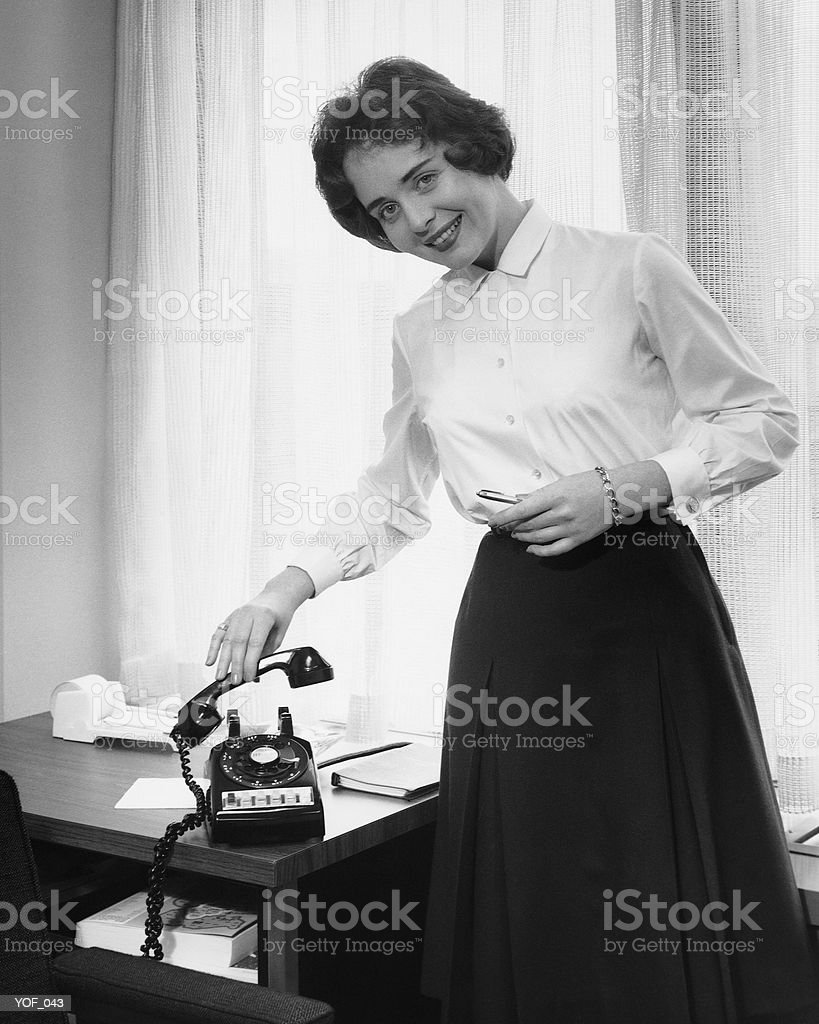 Woman holding phone royalty-free stock photo