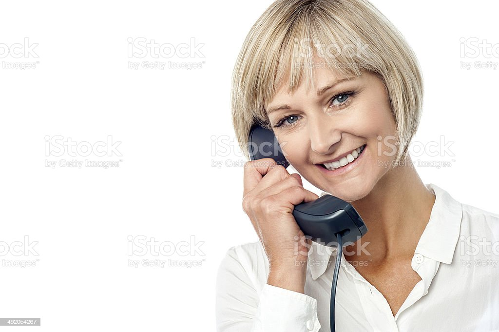 Woman holding phone receiver stock photo