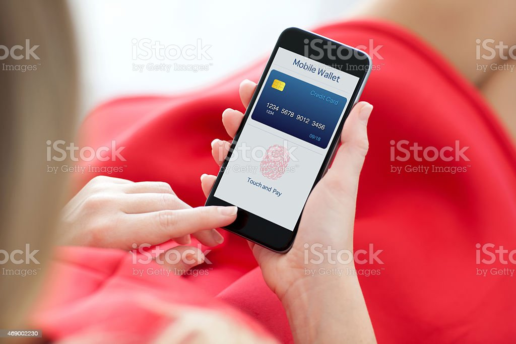 woman holding phone with fingerprint for online shopping stock photo