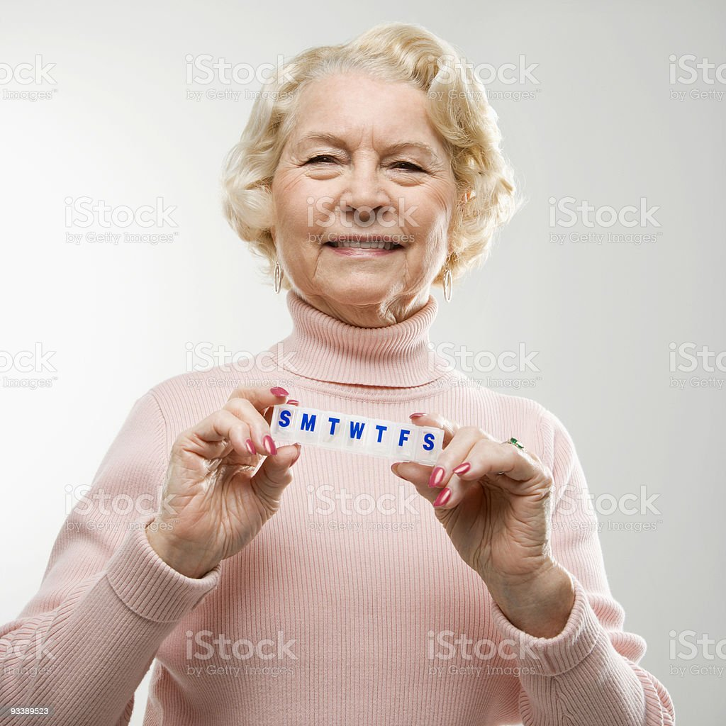 Woman holding pill box. royalty-free stock photo