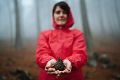 Woman holding pine cone