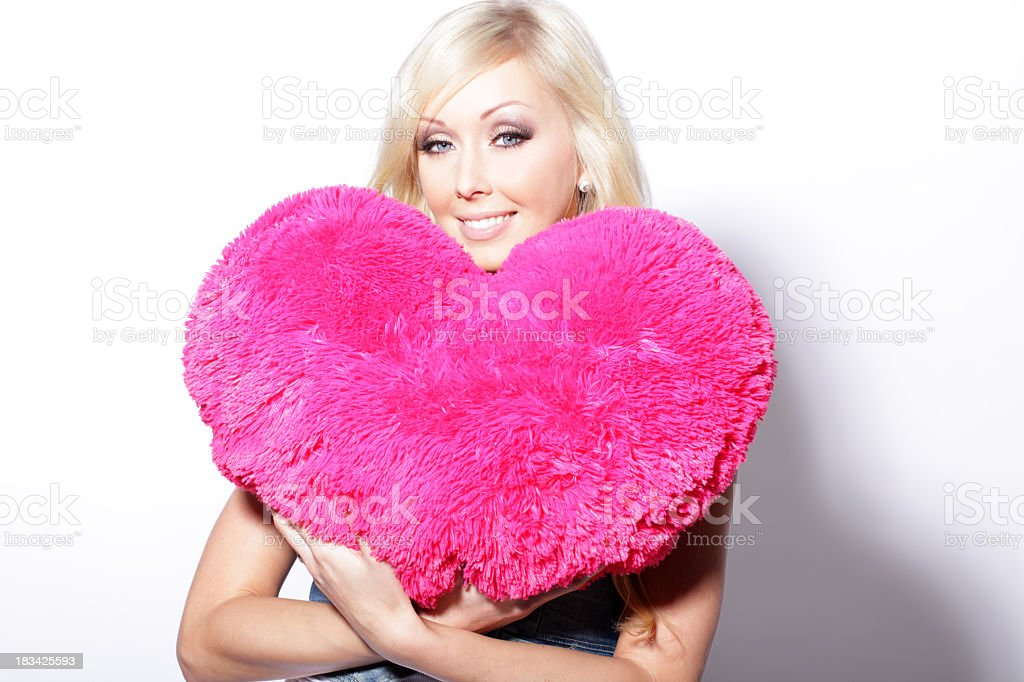 Woman holding pink heart royalty-free stock photo