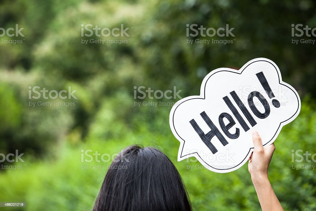 Woman Holding Placard with Text Hello stock photo