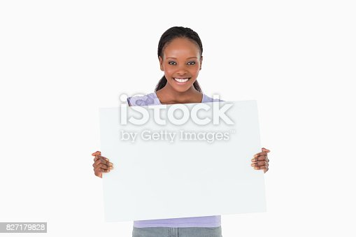 istock Woman holding placeholder in her hands on white background 827179828