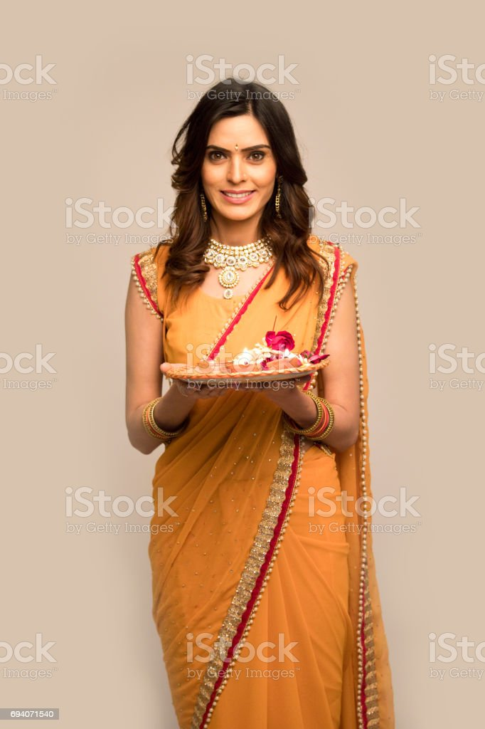 Woman holding plate of religious offering stock photo