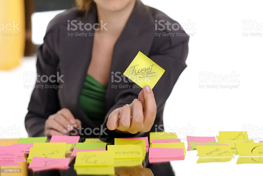 woman holding post-it royalty-free stock photo