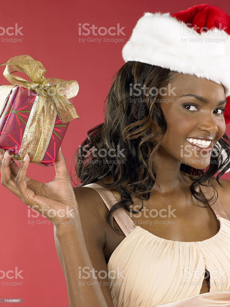 Woman holding present royalty-free stock photo