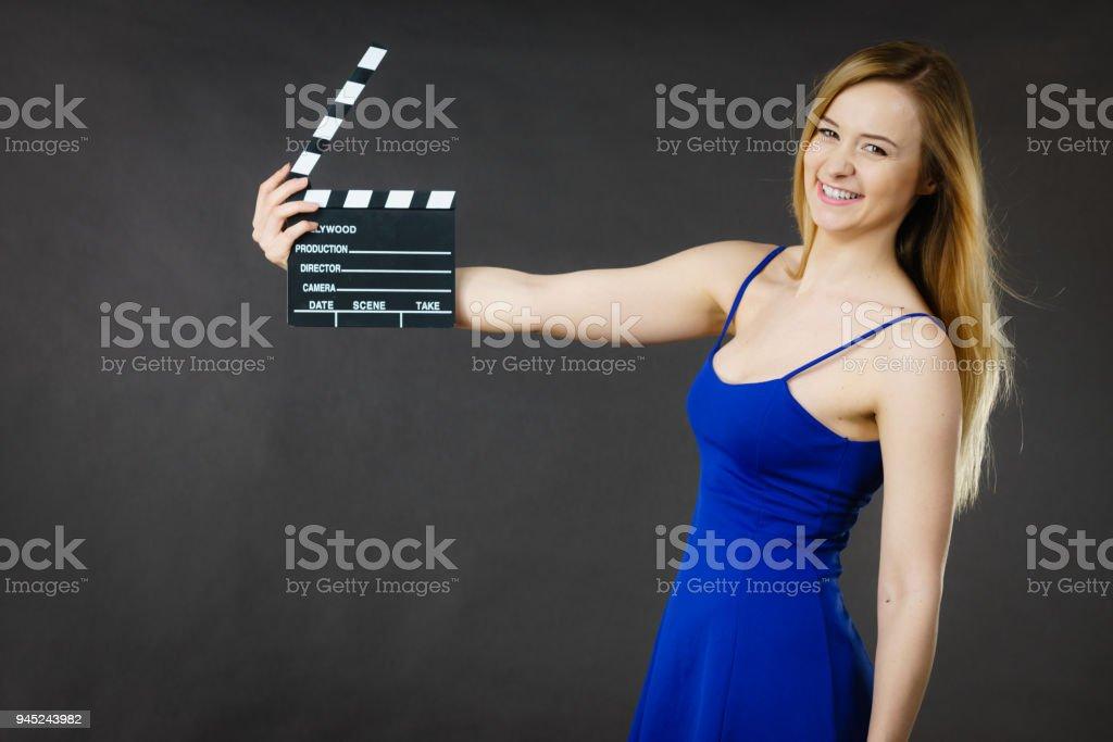 Woman holding professional film slate stock photo