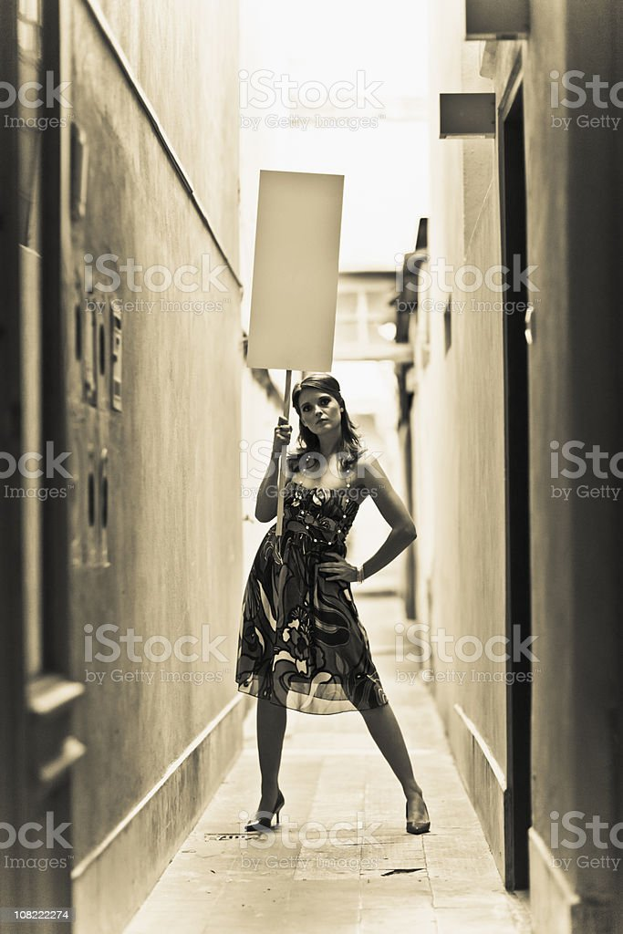 Woman Holding Protest Sign royalty-free stock photo