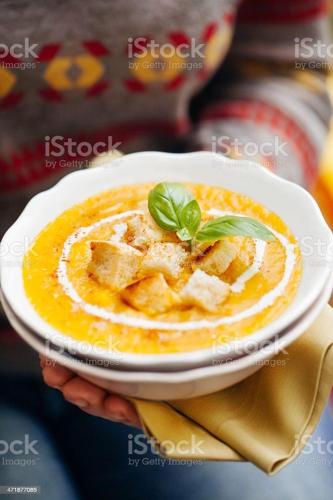 Woman holding pumpkin soup stock photo