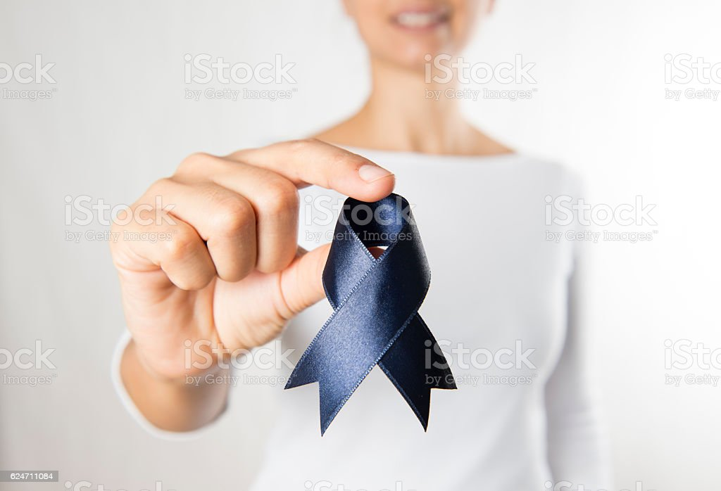 Woman Holding Purple Ribbon stock photo