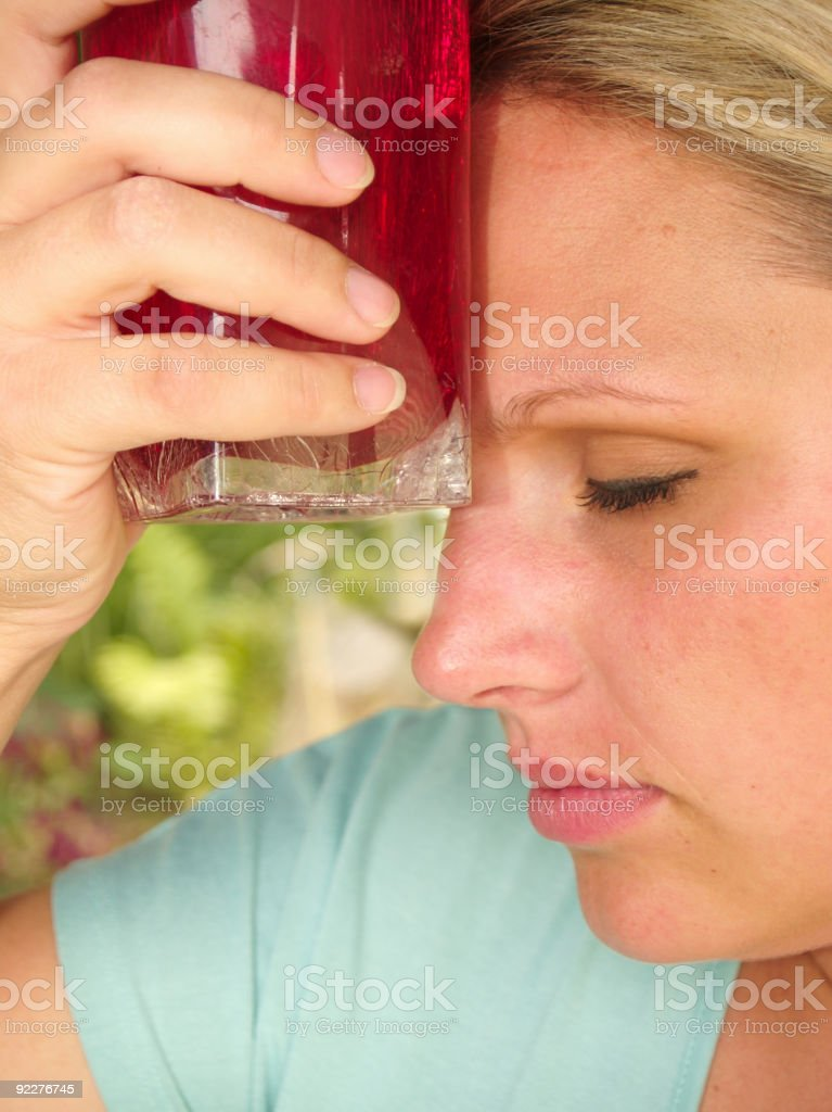 Woman holding red cup to head royalty-free stock photo