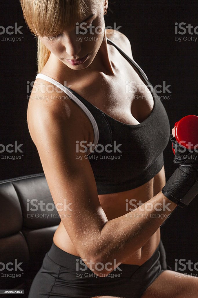 woman holding red dumbbell stock photo