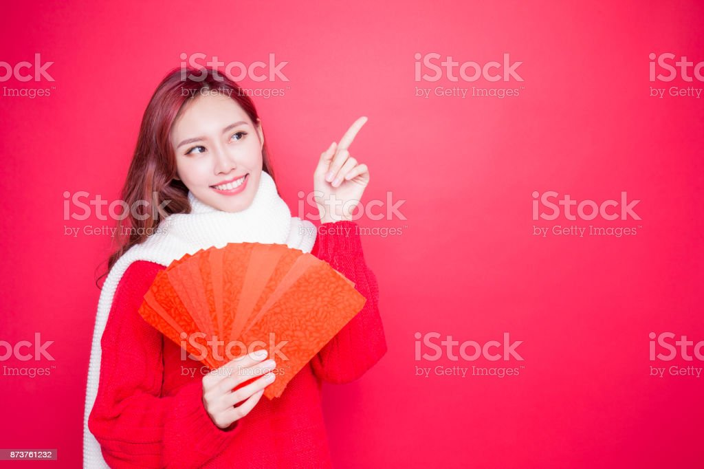 woman holding red envelope royalty-free stock photo