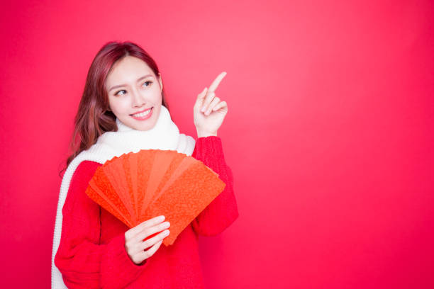 woman holding red envelope stock photo