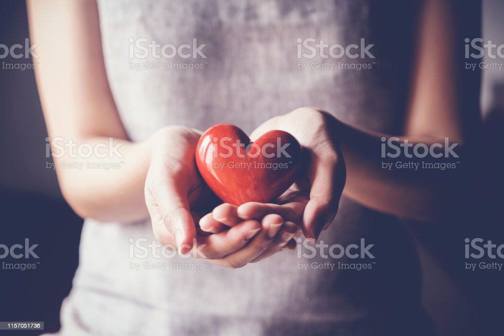 woman holding red heart, health insurance, donation charity concept - Royalty-free Adulto Foto de stock
