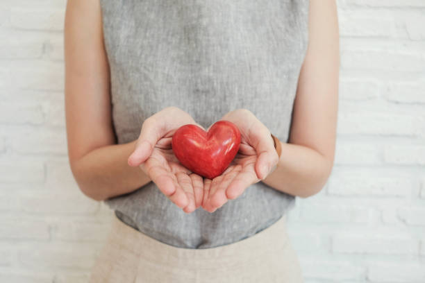 Woman holding red heart health insurance donation charity concept picture id1157053743?b=1&k=6&m=1157053743&s=612x612&w=0&h=jc6on2utqcylo5w4eord8  uuncrhz71fzv9wugj4jc=