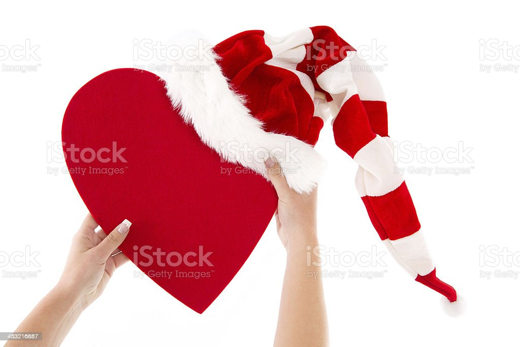 Woman holding red heart with santa hat isolated on white. - Stock image . 28c3761ff56