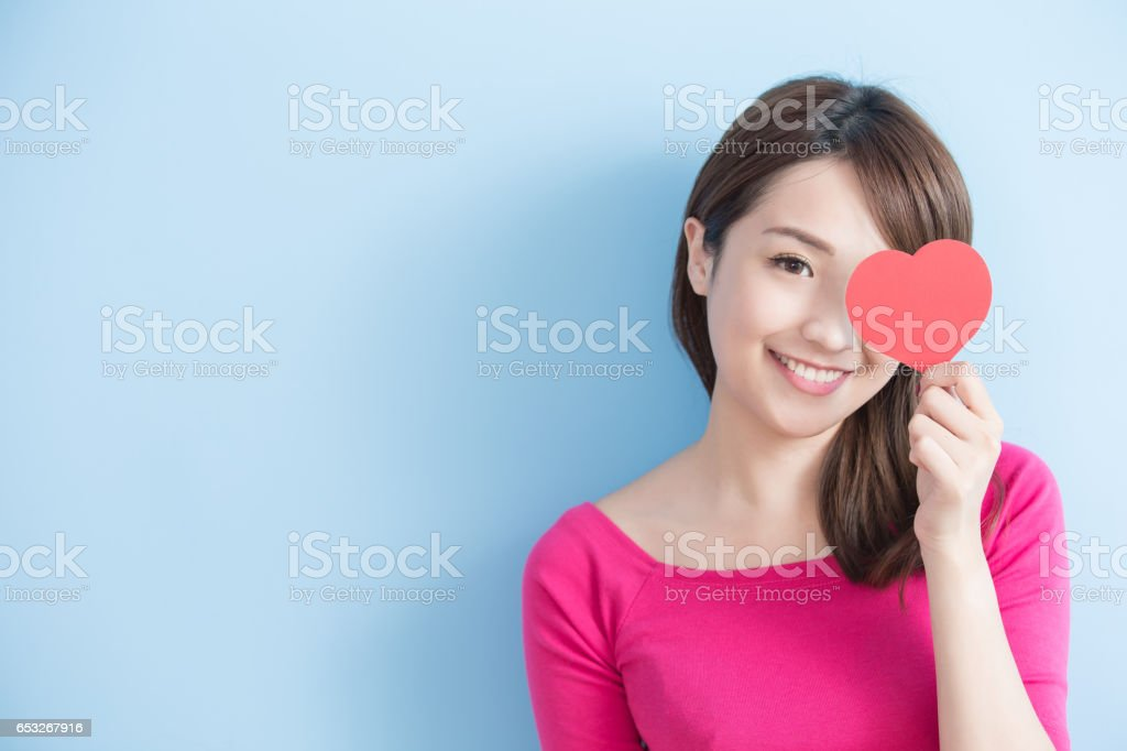 woman holding red love hearts stock photo