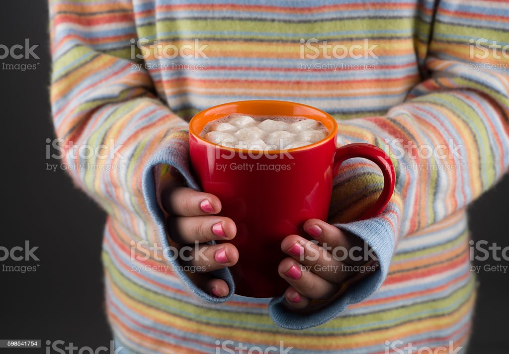 Woman Holding Red Mug with Hot Cocoa photo libre de droits