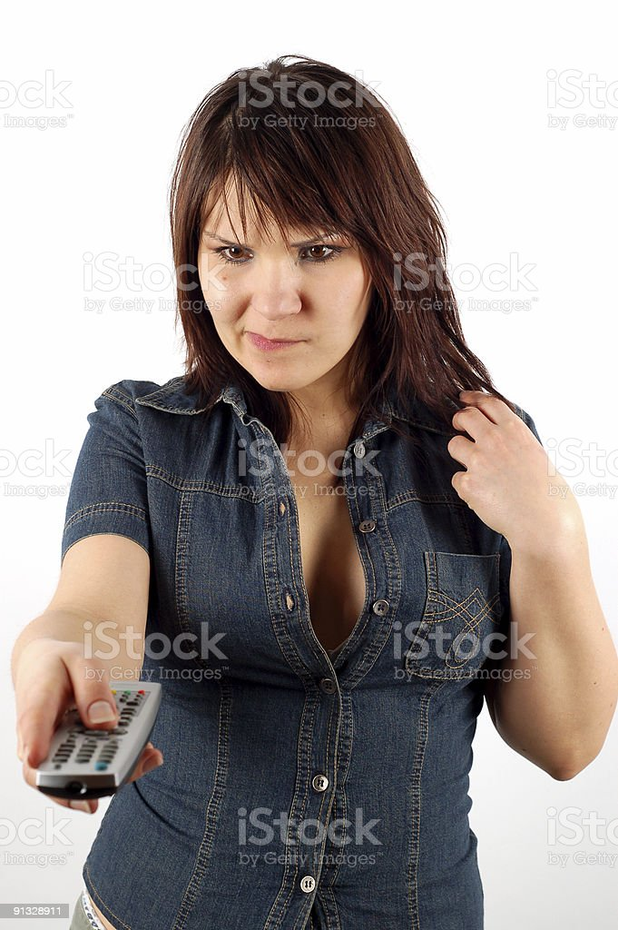 woman holding remote control royalty-free stock photo