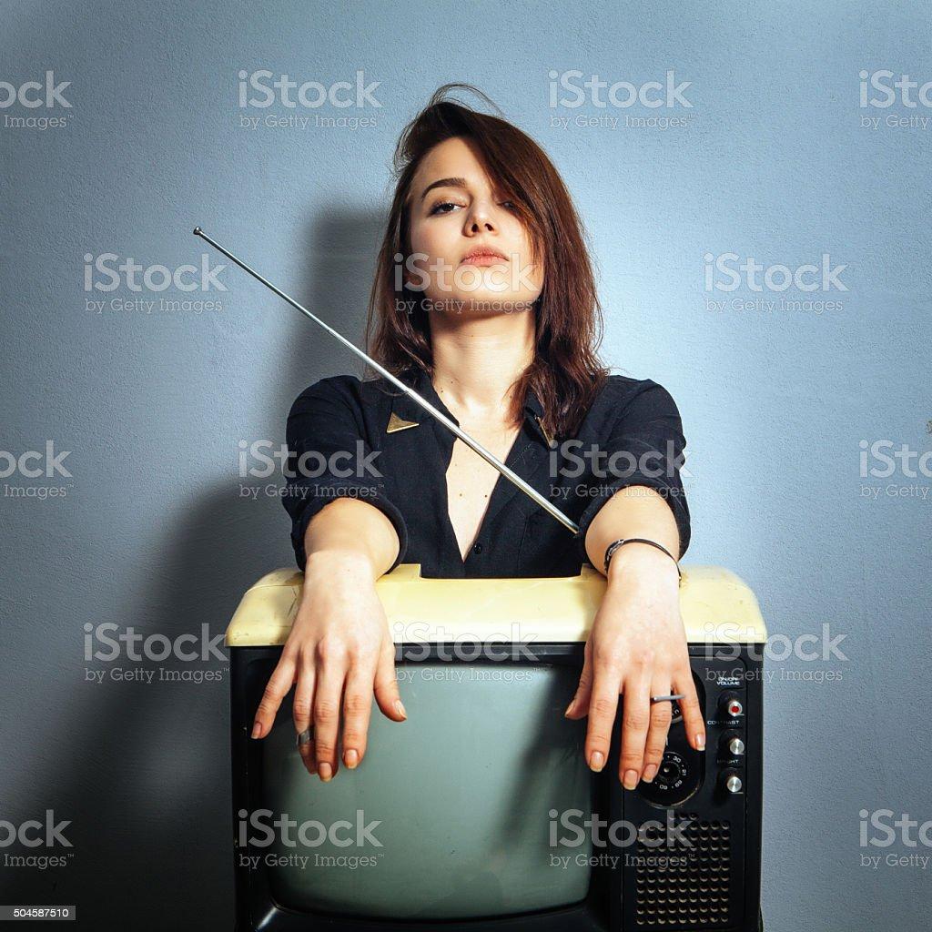 Woman holding retro syle television stock photo
