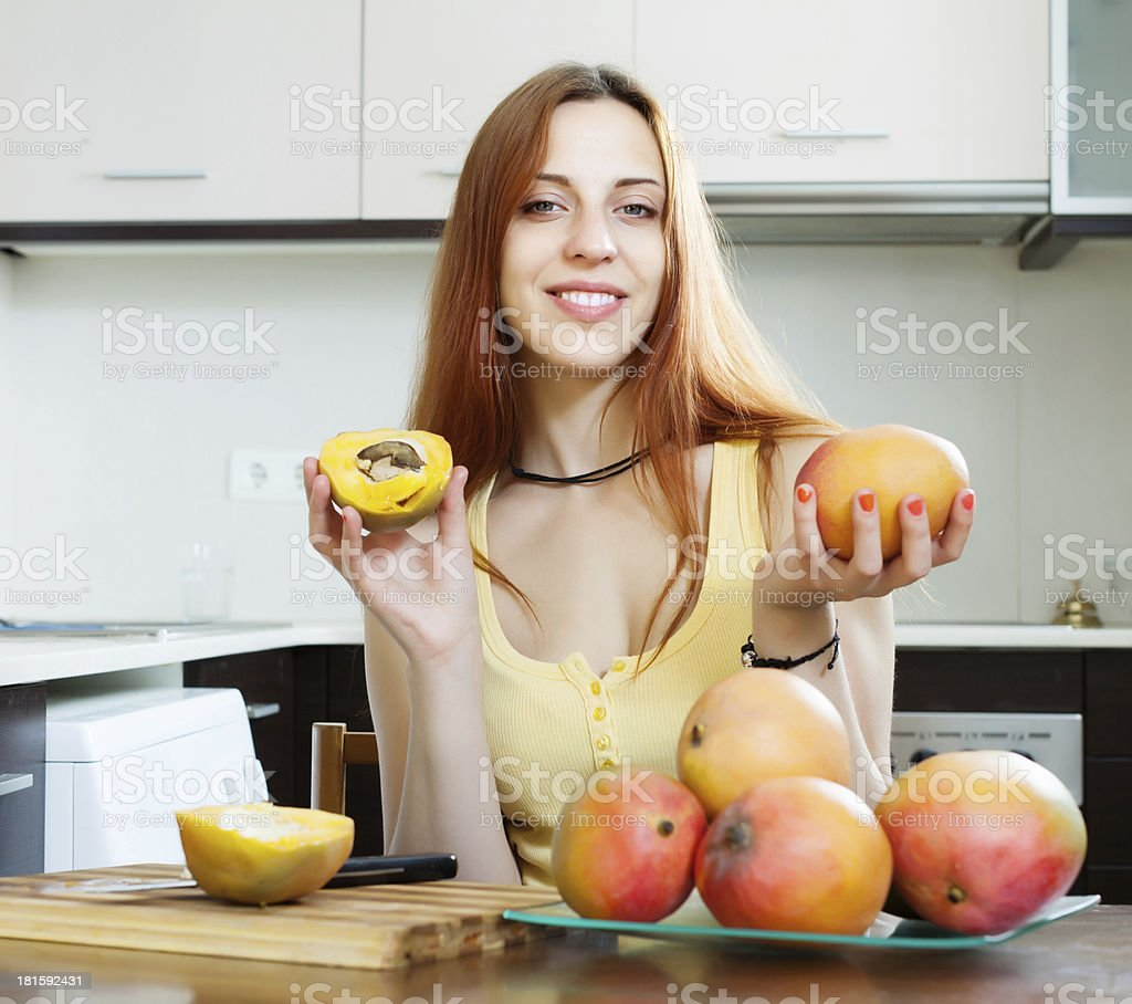 woman holding  ripe mango  at  kitchen royalty-free stock photo