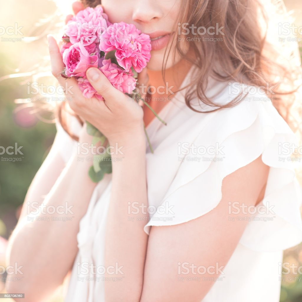 Woman holding roses stock photo