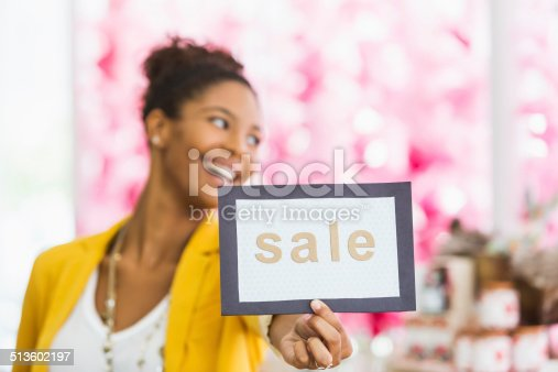 istock Woman holding SALE sign 513602197