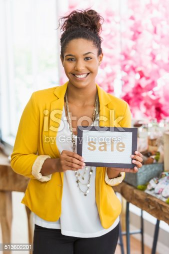 istock Woman holding SALE sign 513602201