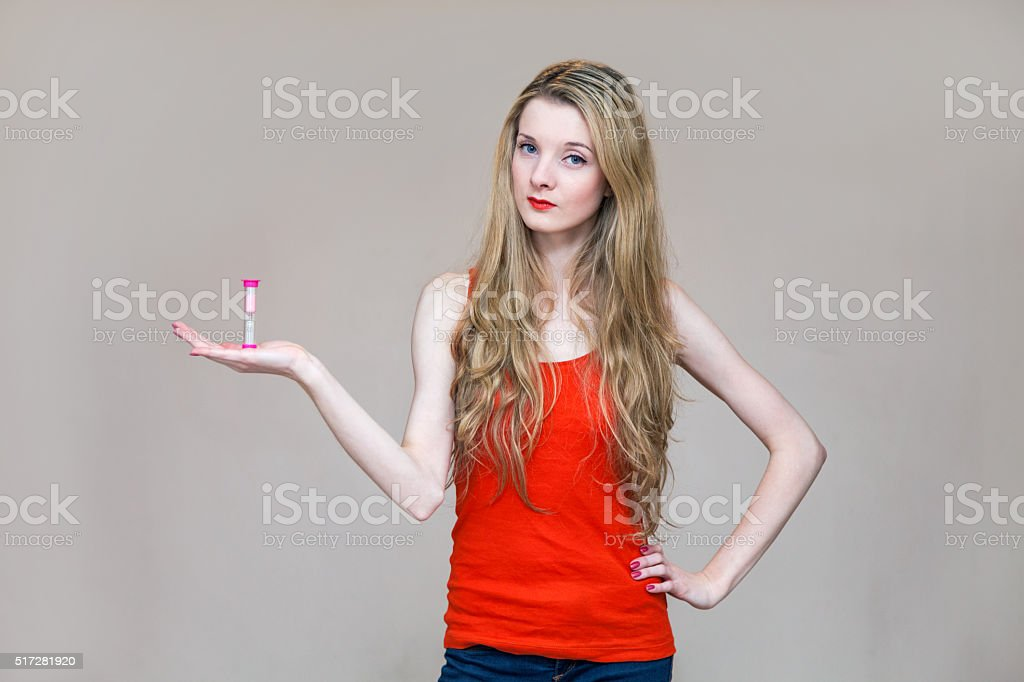 Woman Holding Sandwatch in the Hand stock photo