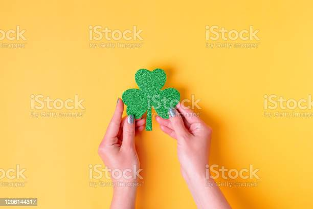 Woman holding shamrock symbol for saint patricks day on bright yellow picture id1206144317?b=1&k=6&m=1206144317&s=612x612&h=seer3fwgllrpdvk7lrphjhkla3m1z4yq v2h5bjuqks=