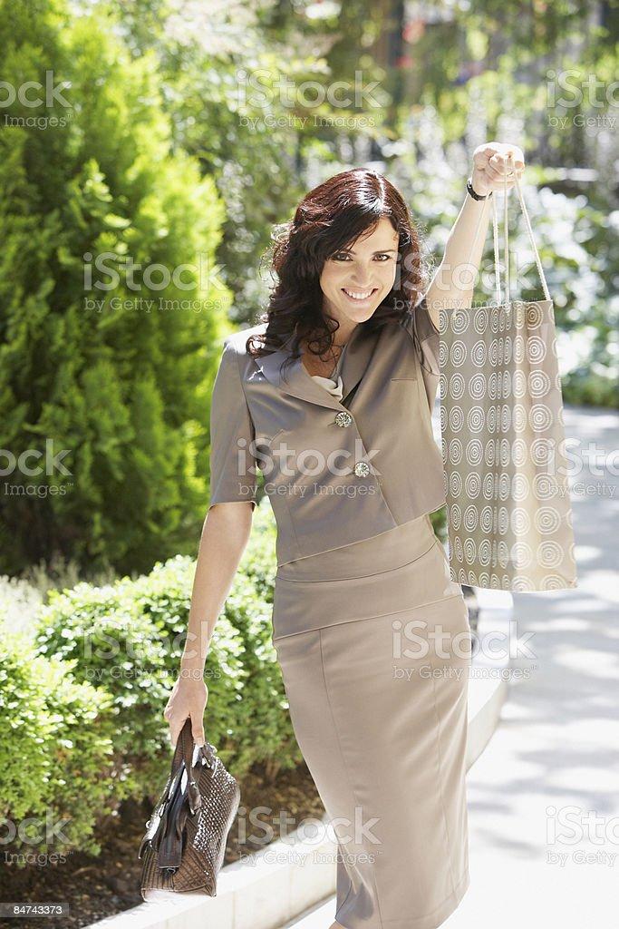 Woman holding shopping bag royalty-free stock photo