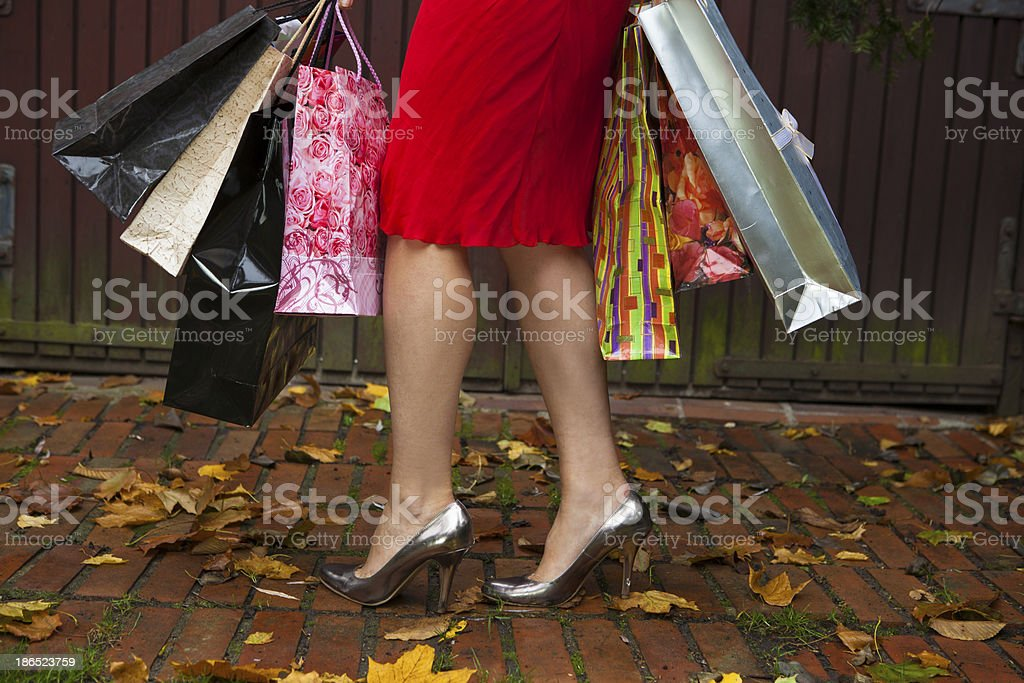 Woman holding shopping bags - autumn sales. royalty-free stock photo